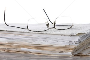 617246_stock-photo-reading-glasses-and-papers